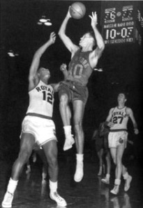 Stokes defends against the New York Knicks' Mel Hutchins during a game in 1958.  Jack Twyman is trailing the play (Courtesy of Jay Twyman).